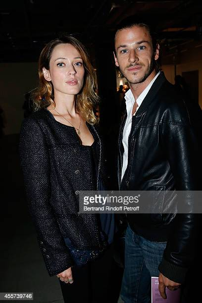 Actor Gaspard Ulliel and Gaelle Pietri attend the Bertrand Bonello's Exhibition Resonances at Centre Pompidou on September 19 2014 in Paris France