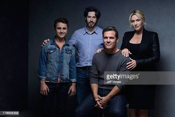 Actor Gattlin Griffith director Jason Reitman actor Josh Brolin and actress Kate Winslet of 'Labor Day' pose at the Guess Portrait Studio during 2013...