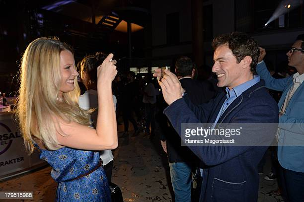 Actor Gedeon Burkhard and girlfriend Anika Bormann attend the Universal Channel launch party at Brienner Forum on September 4 2013 in Munich Germany