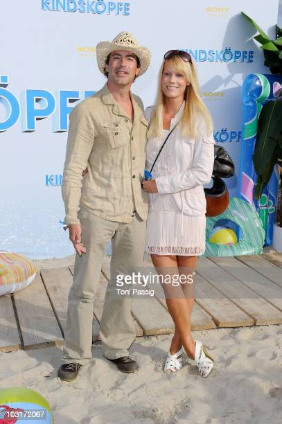 Actor Gedeon Burkhard Annika Bormann attend the Beach BBQ for the German Premiere of 'Kindskoepfe' at O2 World on July 30 2010 in Berlin Germany