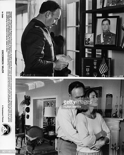 actor Gene Hackman reads in a scene Gene Hackman and Gail Strickland hug in a scene in the Paramount movie 'Uncommon Valor'