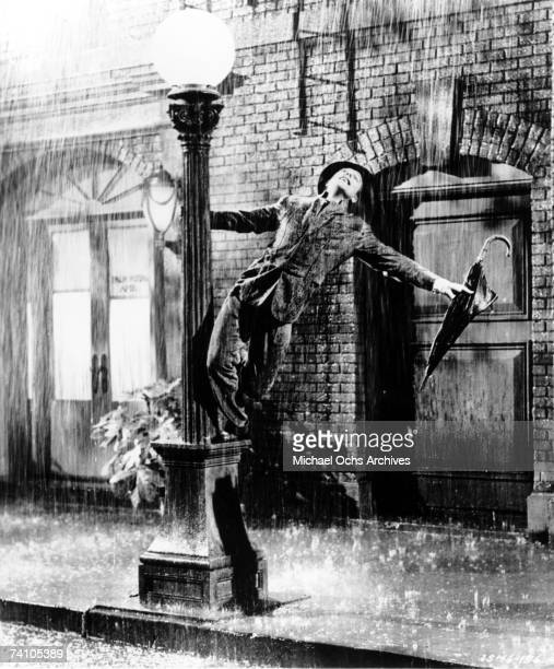 Actor Gene Kelly performs song 'Singin' In The Rain' from movie of same name 'Singin' In The Rain' was directed by Stanley Donan and Gene Kelly