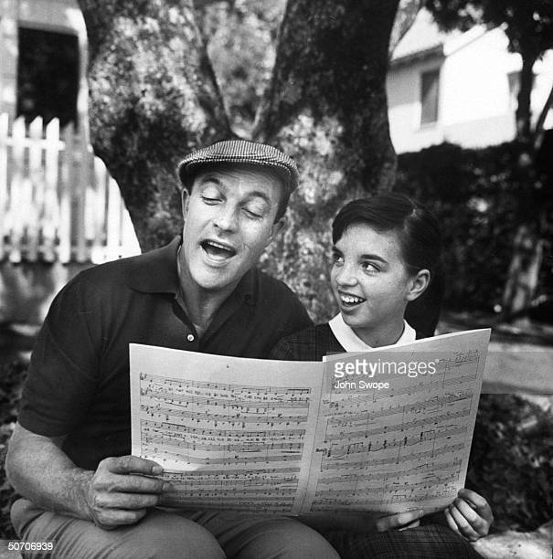 Actor Gene Kelly singing with actress Liza Minnelli