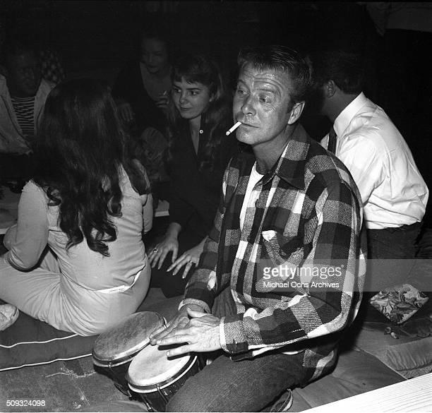 Actor Gene Nelson plays the bongos at Pandora's Coffee House on Sunset Boulevard in Los AngelesCalifornia Gene Nelsonn