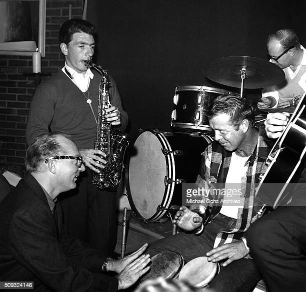 Actor Gene Nelson plays the bongos with jazz players at Pandora's Coffee House on Sunset Boulevard in Los AngelesCalifornia Gene Nelson