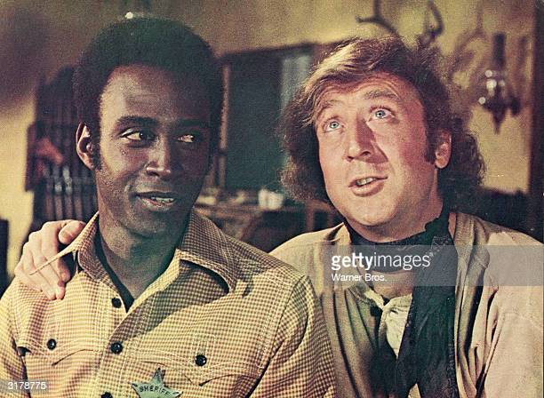Actor Gene Wilder puts his arm around the shoulder of Cleavon Little in a still from the film, 'Blazing Saddles,' directed by Mel Brooks, 1974.