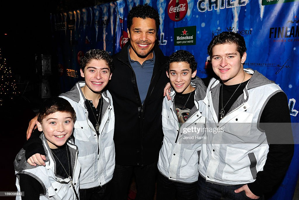 Actor Geno Segers poses with the Ochoa Boys at the CHILL-OUT closing night concert at The Queen Mary on January 6, 2013 in Long Beach, California.