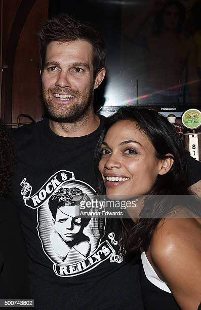 Actor Geoff Stults and actress Rosario Dawson work behind the bar at Geoff Stults' birthday party fundraiser to benefit The Charlotte and Gwenyth...