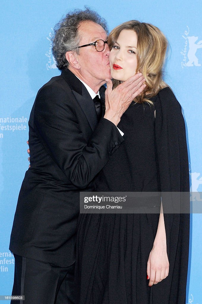 Actor Geoffrey Rush kisses actress Sylvia Hoeks as they attend 'The Best Offer' Photocall during the 63rd Berlinale International Film Festival at the Grand Hyatt Hotel on February 12, 2013 in Berlin, Germany.