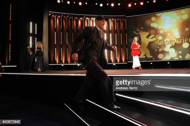 Actor Georg Friedrich going on stage as he receives Silver Bear for Best Actor Award for the movie 'Bright Nights' during the closing ceremony of the...