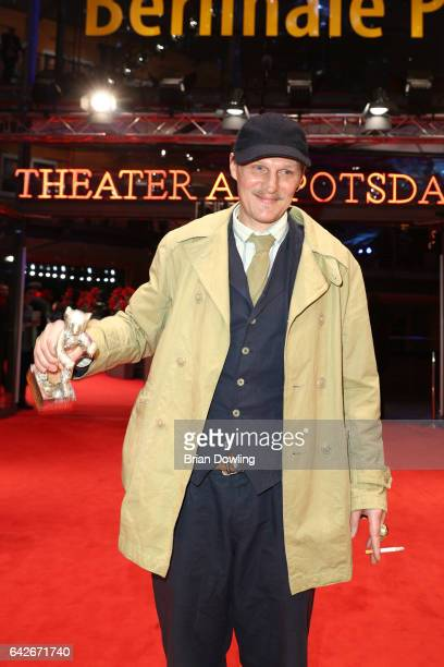 Actor Georg Friedrich pose with Silver Bear for Best Actor Award for the movie 'Bright Nights' after the closing ceremony of the 67th Berlinale...