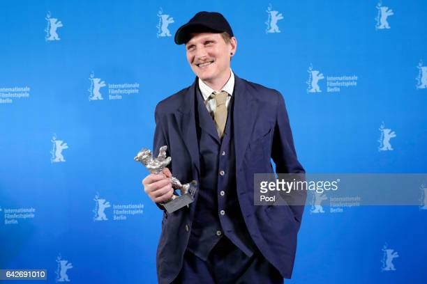 Actor Georg Friedrich poses with his Silver Bear for Best Actor backstage after the closing ceremony of the 67th Berlinale International Film...