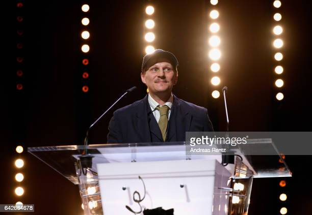 Actor Georg Friedrich speaks on stage as he receives Silver Bear for Best Actor Award for the movie 'Bright Nights' during the closing ceremony of...