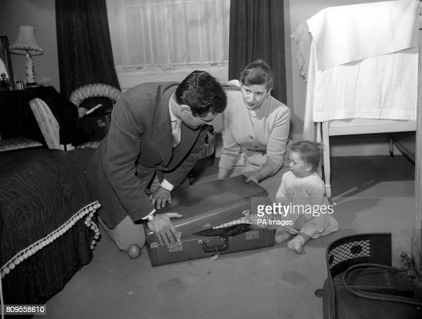 Actor George Baker and his wife Julia Squire with their tenmonthold daughter Candida prepare at their London flat for their departure for the Cannes...