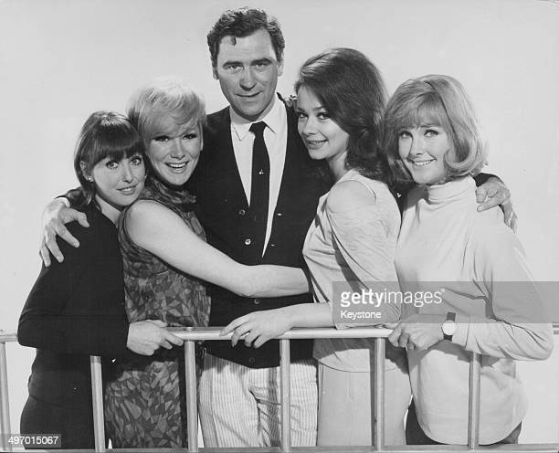 Actor George Baker with a group of young actresses Una Stubbs Joyce Blair Nicole Shelby and Wanda Ventham all appearing together in the comedy 'Mr...