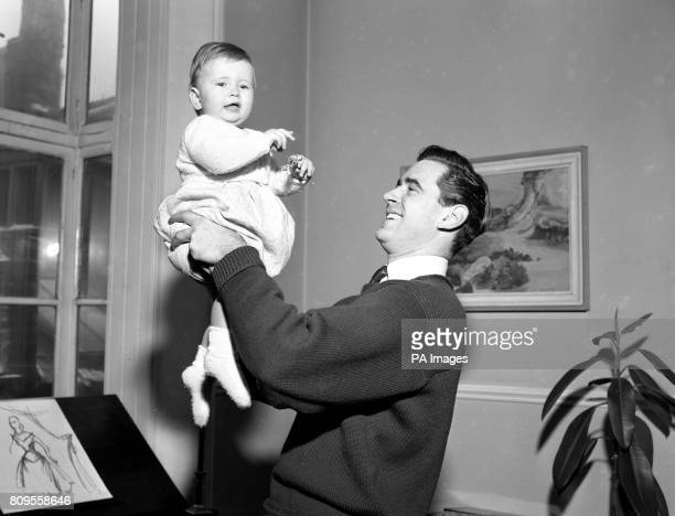 Actor George Baker with his tenmonthold daughter Candida