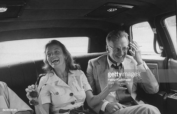 Actor George C Scott and his wife Trish Van Devere riding in a car during their visit to the city of Union
