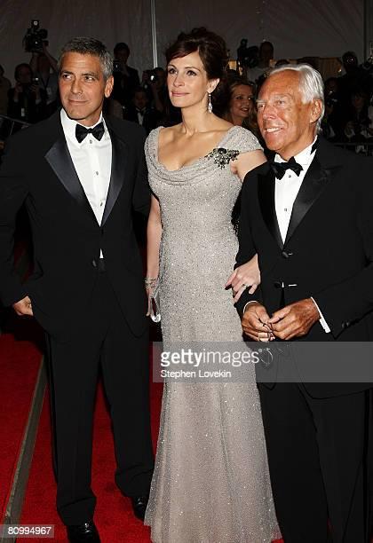 Actor George Clooney actress Julia Roberts and designer Giorgio Armani arrive at the Metropolitan Museum of Art Costume Institute Gala Superheroes...