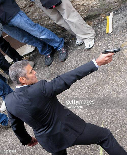 US actor George Clooney acts during the shooting in Castel del Monte near L'Aquila of the movie The American directed by Anton Corbijn on June 222010...