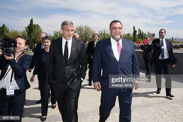 Actor George Clooney and 100 Lives CoFounder Ruben Vardanyan attend the laying of the flowers at the Genocide Memorial in Yerevan Armenia for the...