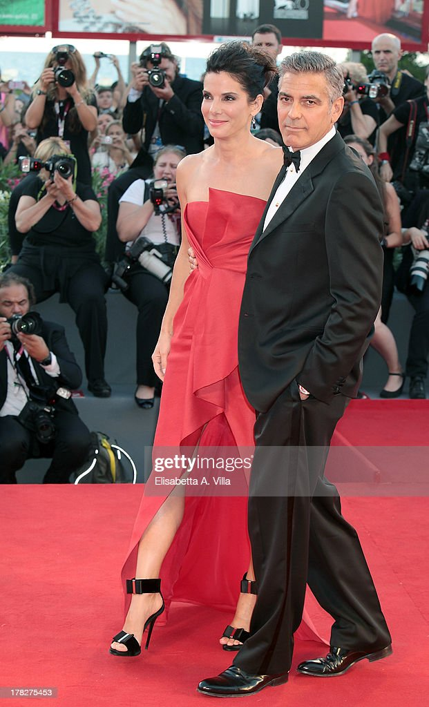 Actor George Clooney and actress Sandra Bullock attend 'Gravity' Premiere and Opening Ceremony during the 70th Venice International Film Festival at the Palazzo del Cinema on August 28, 2013 in Venice, Italy.