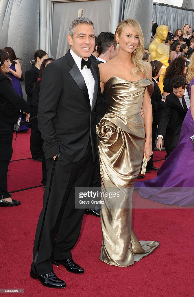 Actor George Clooney and actress Stacy Keibler arrive at the 84th Annual Academy Awards held at the Hollywood & Highland Center on February 26, 2012 in Hollywood, California.