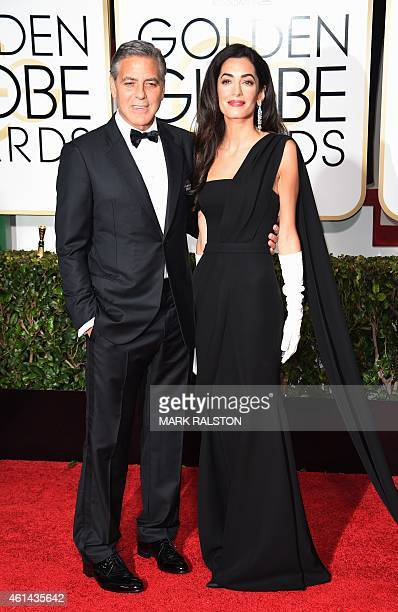 Actor George Clooney and Amal Clooney arrive on the red carpet for the 72nd annual Golden Globe Awards January 11 2015 at the Beverly Hilton Hotel in...