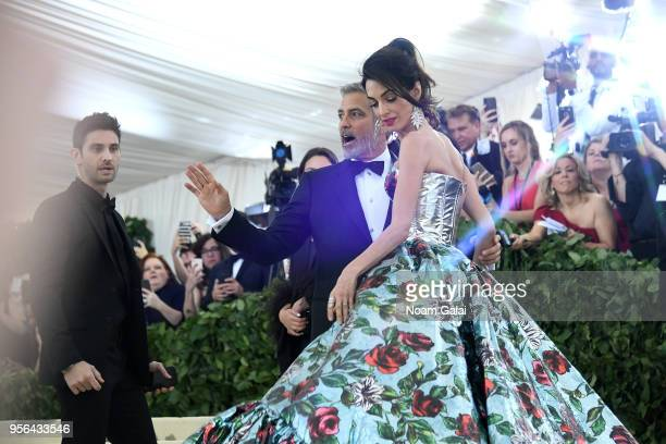Actor George Clooney and Amal Clooney attends the Heavenly Bodies Fashion The Catholic Imagination Costume Institute Gala at The Metropolitan Museum...