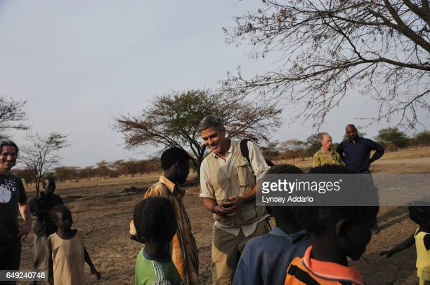 Actor George Clooney and American human rights activist John Prendergast walk through a camp for South Sudanese returnees from North Sudan...