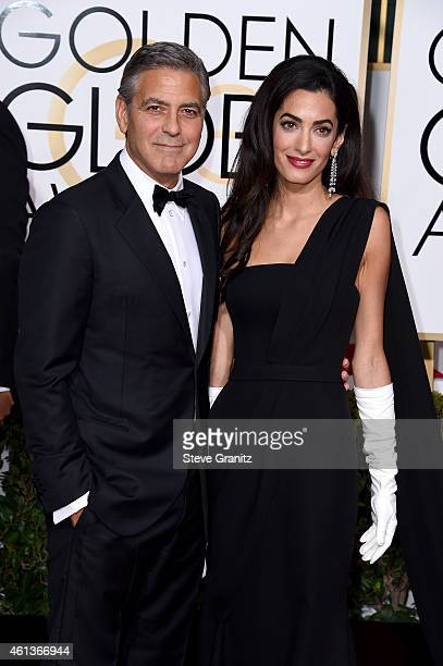 Actor George Clooney and attorney Amal Alamuddin Clooney attend the 72nd Annual Golden Globe Awards at The Beverly Hilton Hotel on January 11, 2015...