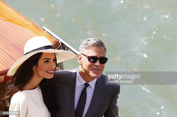 US actor George Clooney and British lawyer Amal Alamuddin leave the palazzo Ca Farsetti on a taxi boat on September 29 2014 in Venice after a civil...