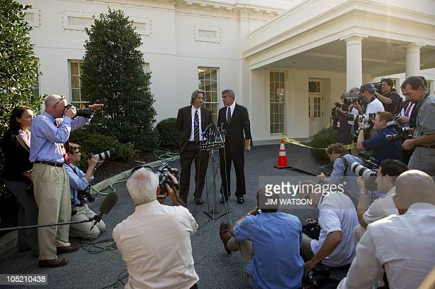 Actor George Clooney and codirector of ENOUGH Project John Prendergast speak to reporters at the White House after a meeting with US President Barack...