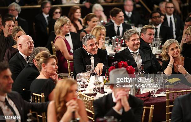 Actor George Clooney and director John Wells in the audience at the 2013 BAFTA LA Jaguar Britannia Awards presented by BBC America at The Beverly...