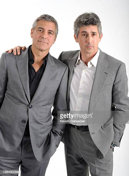 Actor George Clooney and filmmaker Alexander Payne pose for a portrait during the 84th Academy Awards Nominations Luncheon at The Beverly Hilton...