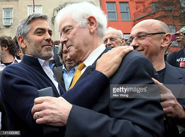 Actor George Clooney and his journalist father Nick Clooney share a moment as President of United to End Genocide Tom Andrews looks on during a...