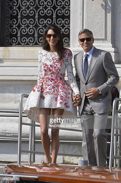 US actor George Clooney and his wife Amal Alamuddin leave the Aman Hotel on September 28 2014 in Venice Hollywood heartthrob George Clooney and...