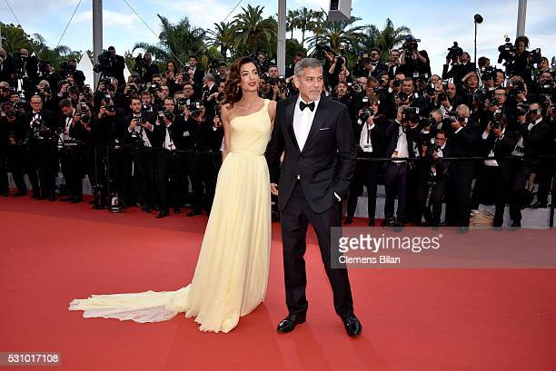 "Actor George Clooney and his wife Amal Clooney attend the ""Money Monster"" premiere during the 69th annual Cannes Film Festival at the Palais des..."