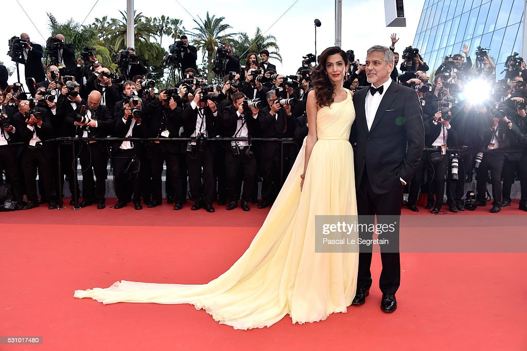 Actor George Clooney and his wife Amal Clooney attend the 'Money Monster' premiere during the 69th annual Cannes Film Festival at the Palais des Festivals on May 12, 2016 in Cannes, France.
