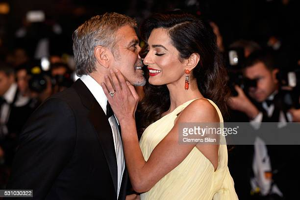 Actor George Clooney and his wife Amal Clooney attend the Money Monster premiere during the 69th annual Cannes Film Festival at the Palais des...