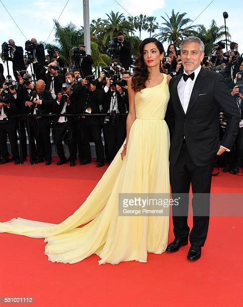 Actor George Clooney and his wife Amal Clooney attend the screening of Money Monster at the annual 69th Cannes Film Festival at Palais des Festivals...