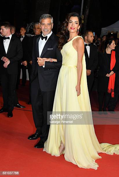 Actor George Clooney and his wife Amal Clooney depart from their screening of Money Monster at the annual 69th Cannes Film Festival at Palais des...