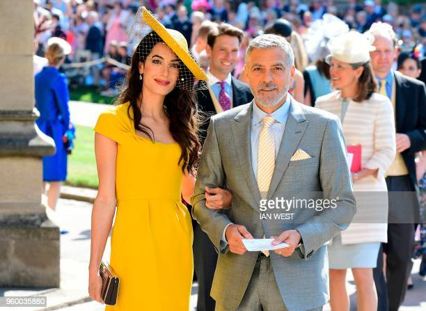 US actor George Clooney and his wife British lawyer Amal Clooney arrive for the wedding ceremony of Britain's Prince Harry Duke of Sussex and US...