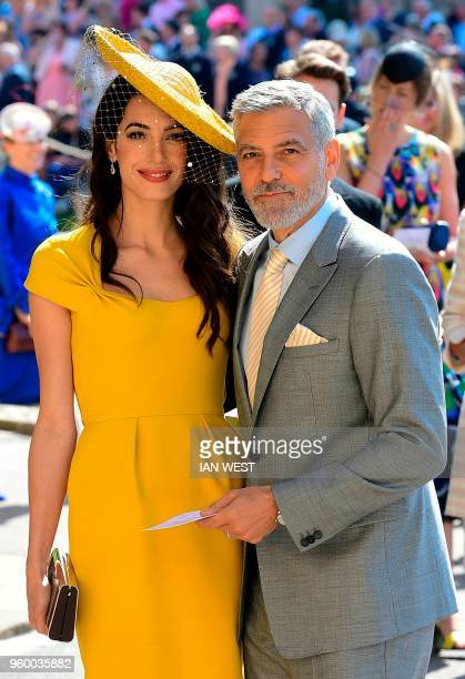 TOPSHOT US actor George Clooney and his wife British lawyer Amal Clooney arrive for the wedding ceremony of Britain's Prince Harry Duke of Sussex and...