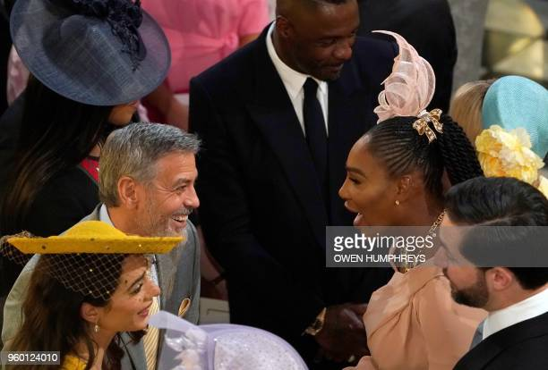 US actor George Clooney and his wife British lawyer Amal Clooney talk with US tennis player Serena Williams and her husband Alexis Ohanian during the...