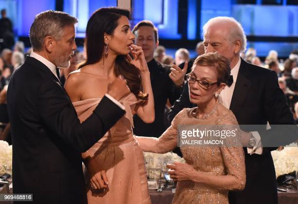 US actor George Clooney and his wife BritishLebanese barrister Amal Clooney speak with Clooney's parents Nina Bruce Warren and Nick Clooney at the...