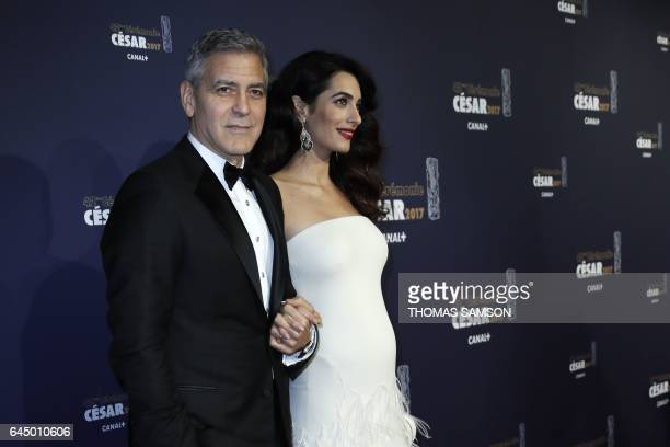 US actor George Clooney and his wife BritishLebanese lawyer Amal Clooney pose as they arrive for the 42nd edition of the Cesar Ceremony at the Salle...