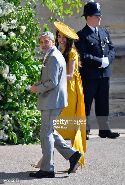 S actor George Clooney and his wife lawyer Amal Clooney arrive at St George's Chapel at Windsor Castle before the wedding of Prince Harry to Meghan...