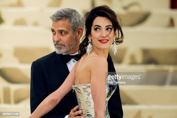 Actor George Clooney and lawyer Amal Clooney enter the Heavenly Bodies: Fashion & The Catholic Imagination Costume Institute Gala at The Metropolitan...