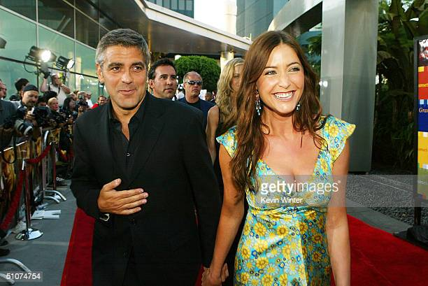 Actor George Clooney and Lisa Snowdon arrive at the premiere of Universal's The Bourne Supremacy at the Arclight Cinemas on July 15 2004 in Los...