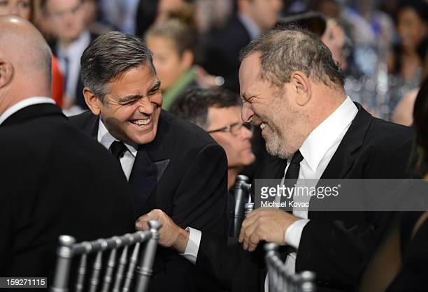 Actor George Clooney and producer Harvey Weinstein attend the Critics' Choice Movie Awards 2013 with Skinnygirl Cocktails at Barkar Hangar on January...